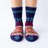 dark blue wool sock with red and light blue details and a beautiful pattern on top, handknitten, vegan and fair trade, frontview
