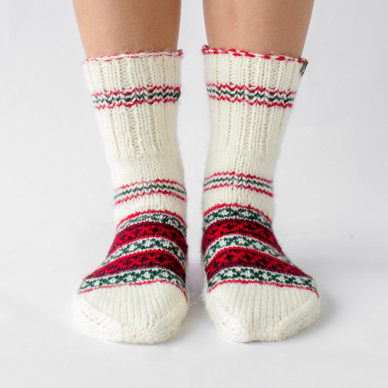 white wool sock with red and green details and pattern, handknitten, vegan and fairtrade wool sock Christmas edition for women front view