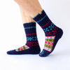 dark blue wool sock with red and light blue details and a beautiful pattern on top, handknitten, vegan and fair trade, sideview