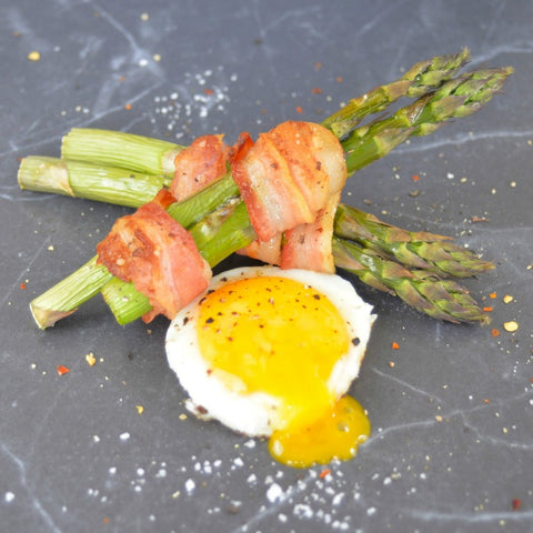 Bacon wrapped asparagus with fried egg yolks