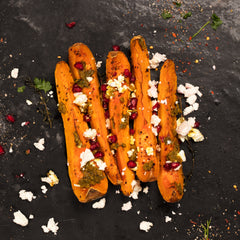 Roast butternut squash with pomegranate seeds, chermoula and feta