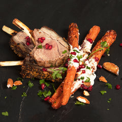 Roast rack of lamb with sweet spear carrots in tahini dressing with pomegranate seeds