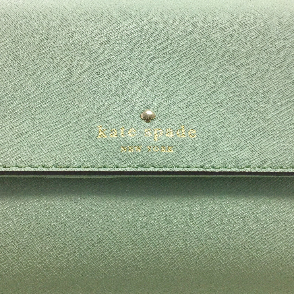 Kate Spade Cedar Street Magnolia embossed signature and stud