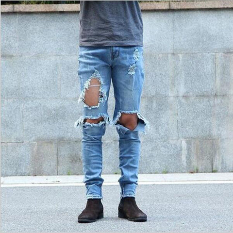 Drop Crotch Stacked Jeans With Rips And Bleaching In Mid Blue