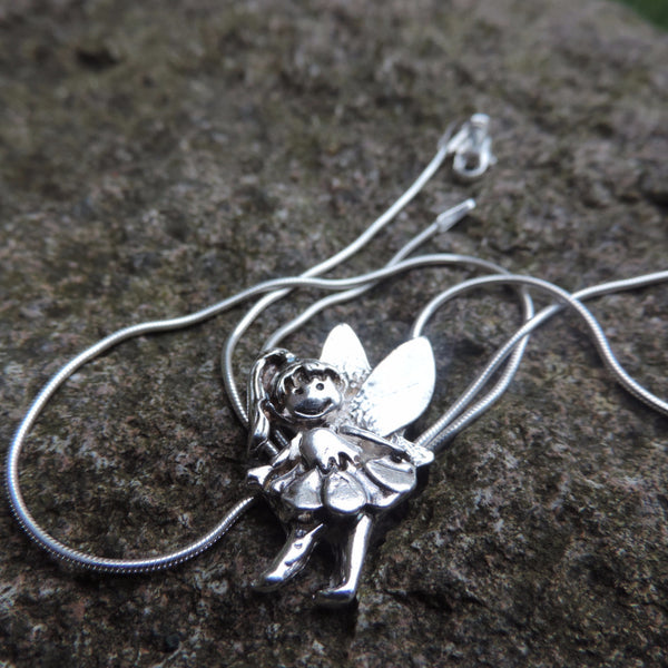 Side ways fairy charm necklace