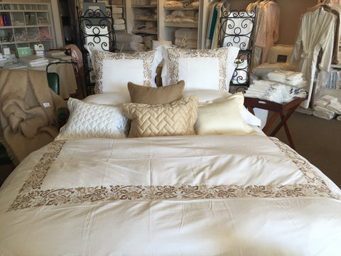 bed linens, pillows, blanket covers on display