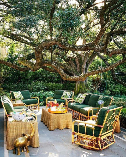 The beautiful backyard of Bailey Mc Carthy with Celerie Kemble 's wicker collection for Lane Venture. House Beautiful. Trevor Tondro photography