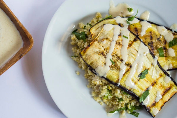 GRILLED EGGPLANT WITH HERBED QUINOA & CUMIN TAHINI DRESSING