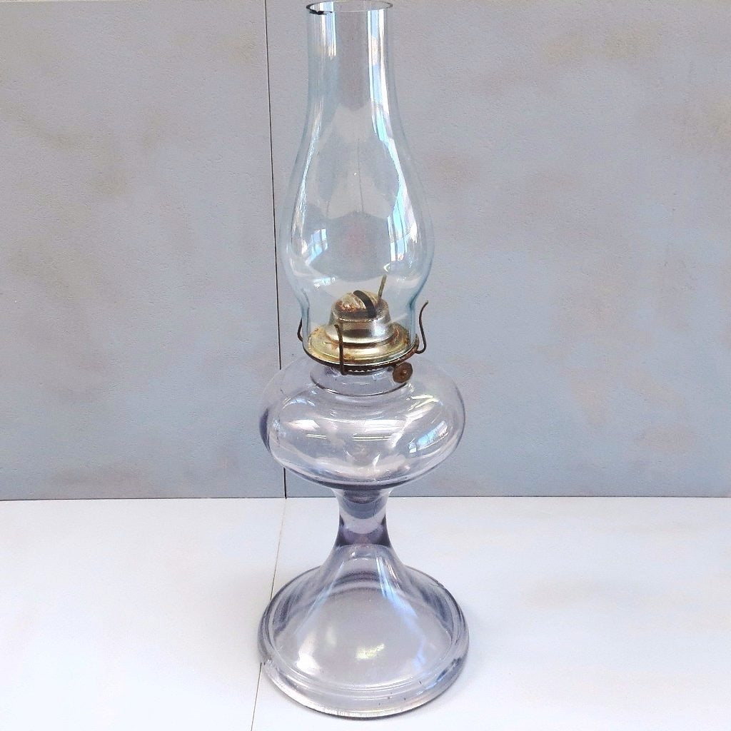 Antique glass oil / kerosene lamp, clear glass base with purple tint (c early 1900s) - Selective Salvage