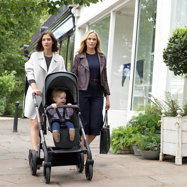 Mom pushing baby in the Silver Cross Wave 2019 stroller in Slate