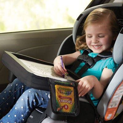 Little girl coloring on Skip Hop Style Driven Travel Activity Tray