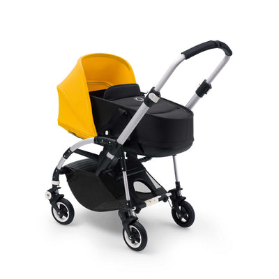 Bugaboo Bee⁵ Bassinet in Black with Sunrise Yellow Canopy on Stroller