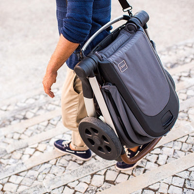 Joolz Hub Earth Stroller folded with carry strap