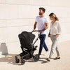 Man and woman pushing the Joolz Hub Stroller