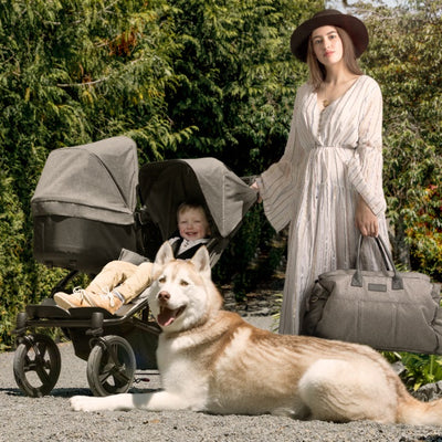 Mom with children in the Mountain Buggy Duet Luxury Herringbone Double Stroller