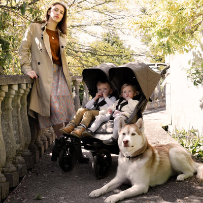 mom and children in the Mountain Buggy Duet Luxury Herringbone Double Stroller