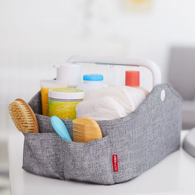 Skip Hop Light Up Diaper Caddy filled with diapers and lotions