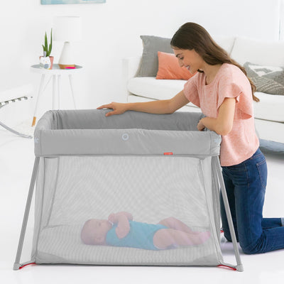 Baby sleeping in the Skip Hop Play To Night™ Expanding Travel Crib