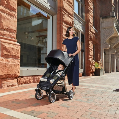 Mom pushing toddler in the Baby Jogger City Mini® 2 4-wheel stroller