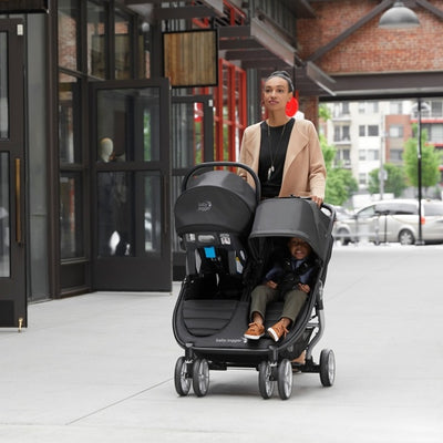 Mom pushing the Baby Jogger City Mini® 2 Double Stroller