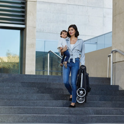 Mom holding baby and the Baby Jogger 2019 City Mini® 2 Stroller