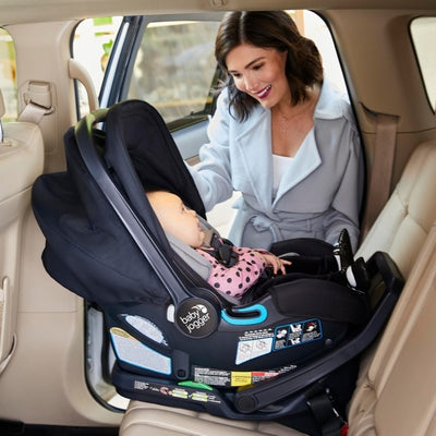 Mom and baby in the Baby Jogger City Go® 2 infant car seat