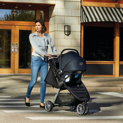 Mom pushing the Baby Jogger City Mini® 2 Travel System