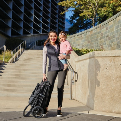 Mom holding baby and the Baby Jogger 2019 City Mini® GT2 Stroller