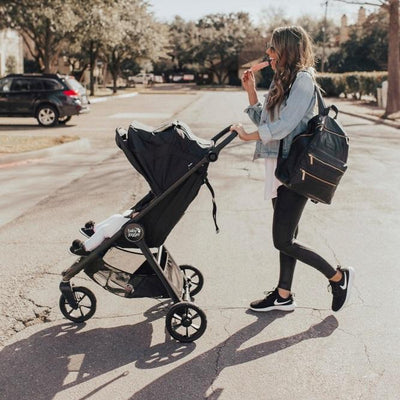 Mom pushing the  Baby Jogger City Mini GT2 stroller