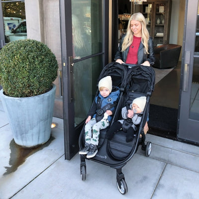 Mom pushing the Baby Jogger 2019 City Tour 2 Double Stroller