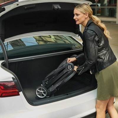 Mom putting the Baby Jogger 2019 City Tour 2 Stroller in the car trunk