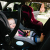 Baby sitting in the Clek Liing Infant Car Seat + Base in car