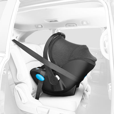 Clek Liing Infant Car Seat in car connected with the seat belt