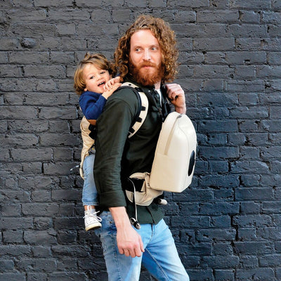 dad wearing the Diono Carus Complete 4-in-1 Baby Carrier