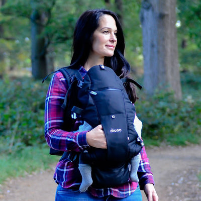 Mom wearing the Diono Carus Complete 4-in-1 Baby Carrier