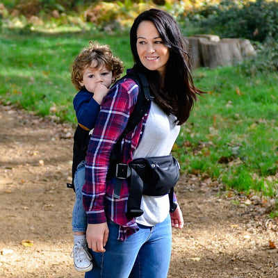 Mom carrying baby in the Diono Carus Essentials 3-in-1 Baby Carrier