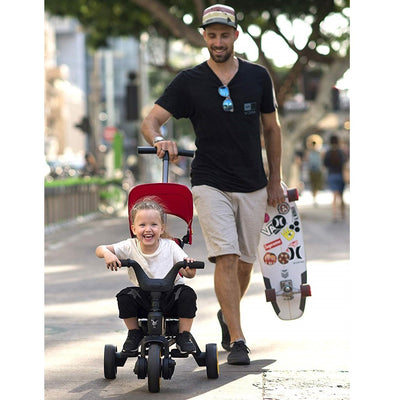 Child and father with the Doona™ Liki Trike S5 in Nitro Black