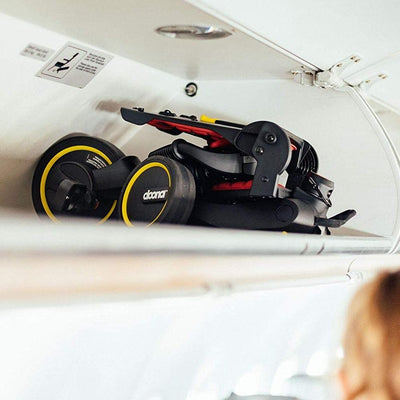 Doona™ Liki Trike S5 in the overhead bin on an airplane