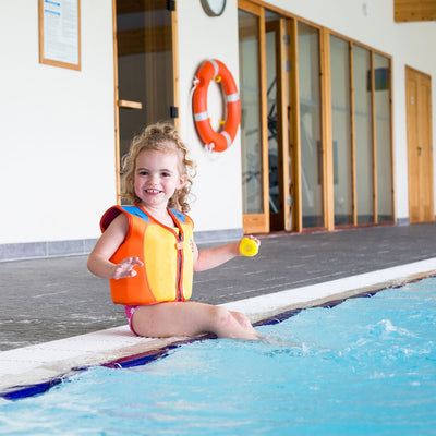 Little girl wearing Konfidence Swim Jacket
