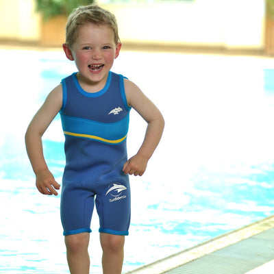 Boy at the pool wearting Konfidence Warma Wetsuit