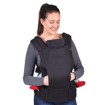 Mom wearing Mountain Buggy Juno Baby Carrier in Black