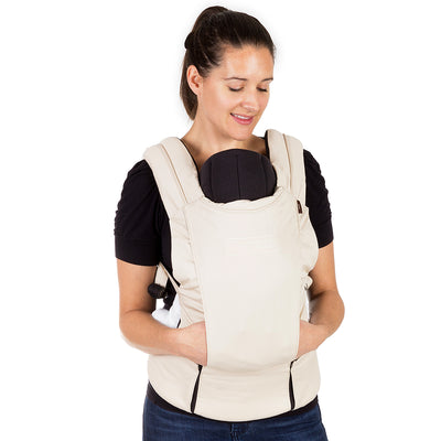 Mom wearing Mountain Buggy Juno Baby Carrier in Sand