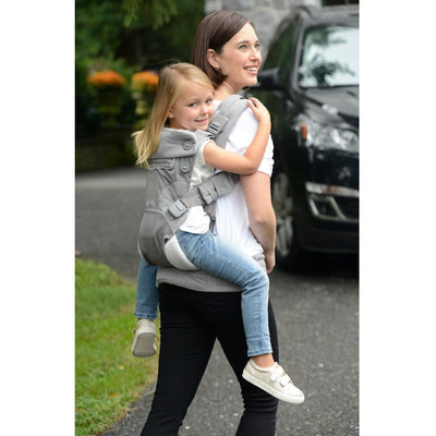 Mom wearing the Nuna CUDL Baby Carrier in Frost