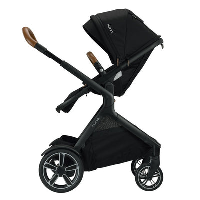 Nuna DEMI™ Grow Stroller + Adapters + Rain Cover + Magnetic Buckle in Caviar with seat reversed