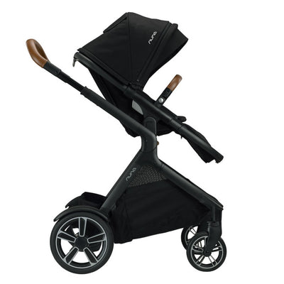 Nuna DEMI™ Grow Stroller + Adapters + Rain Cover + Magnetic Buckle in Caviar side view
