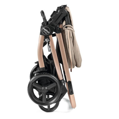 Peg Perego YPSI Stroller in Mon Amour Rose Gold folded with seat attached