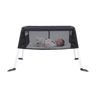 Baby sleeping in the Phil&teds Traveller Bassinet