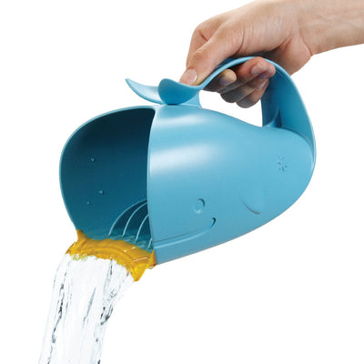 woman pouring water from Skip Hop Moby Waterfall Bath Rinser