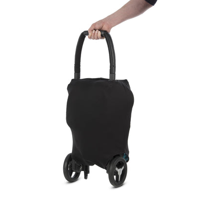 Silver Cross Jet Ultra Compact Stroller in Ebony folded with luggage sleeve