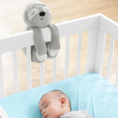 baby sleeping in crib with Skip Hop Cry-Activated Soother in Sloth attached